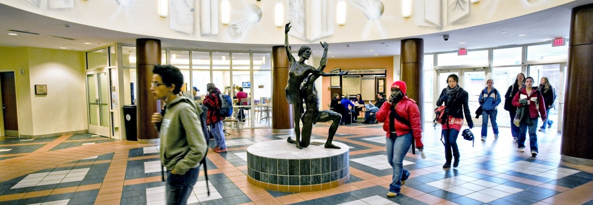 students walking into library lobby